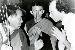 Lama Yeshe 'instructs' Jon Landaw while Gonsar Rinpoche looks on.