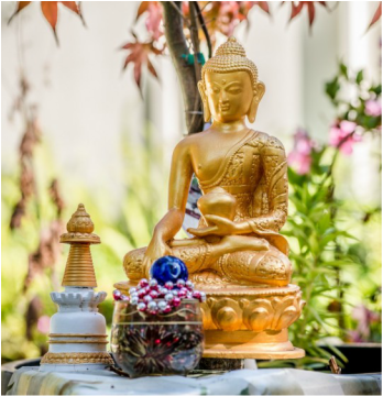 Shakyamuni Buddha with offerings, Kachoe Dechen Ling, California, USA. Photo by Chris Majors.