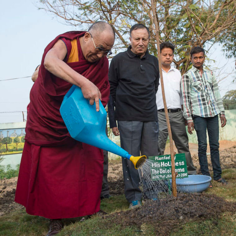 His Holiness the Dalai Lama planting a tree